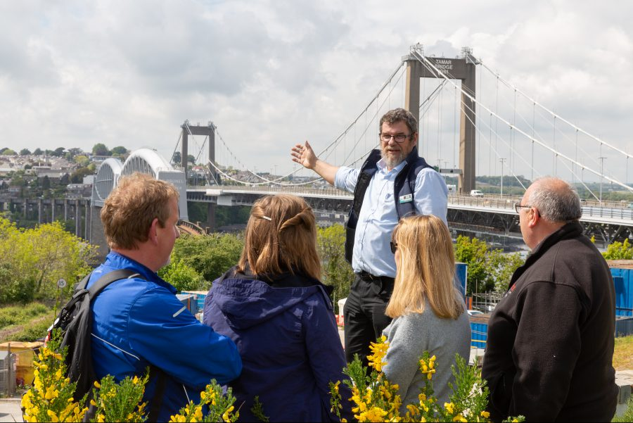 Guide talking to people in front of the Tamar Bridge.